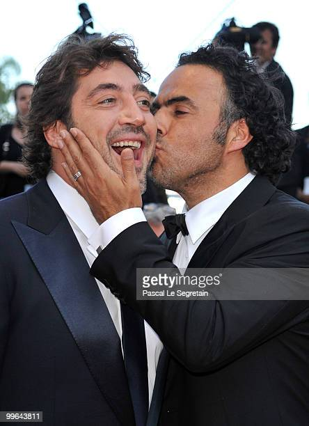 Director Alejandro Gonzalez Inarritu kisses actor Javier Bardem as they attend Biutiful Premiere at the Palais des Festivals during the 63rd Annual...