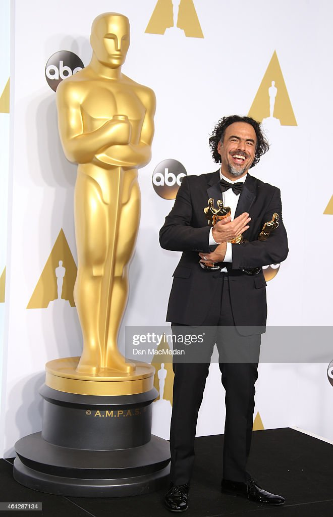 Director Alejandro Gonzalez Inarritu poses in the press room with his awards for Best Director, Best Original Screenplay, and Best Picture at the 87th Annual Academy Awards at Hollywood & Highland Center on February 22, 2015 in Los Angeles, California.