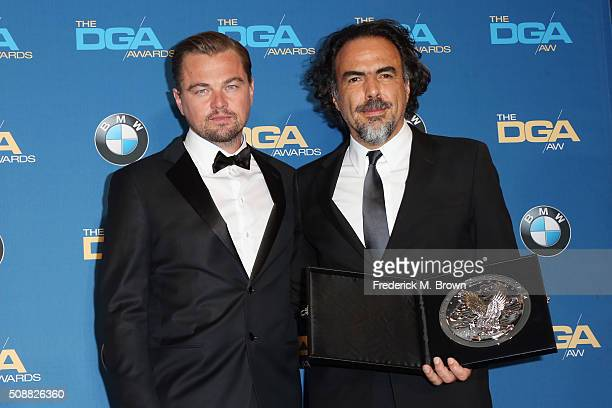 "Director Alejandro Gonzalez Inarritu recipient of the Feature Film Nomination Plaque for ""The Revenant' and actor Leonardo DiCaprio pose in the press..."