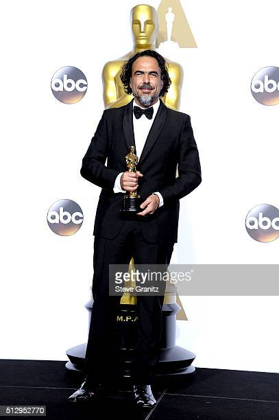 Director Alejandro Gonzalez Inarritu winner of the Best Director award for 'The Revenant' poses in the press room during the 88th Annual Academy...