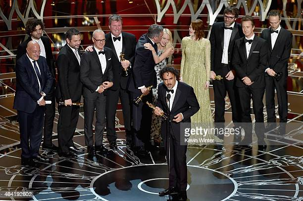 Director Alejandro Gonzalez Inarritu with cast and crew accept the Best Picture award for 'Birdman' onstage during the 87th Annual Academy Awards at...