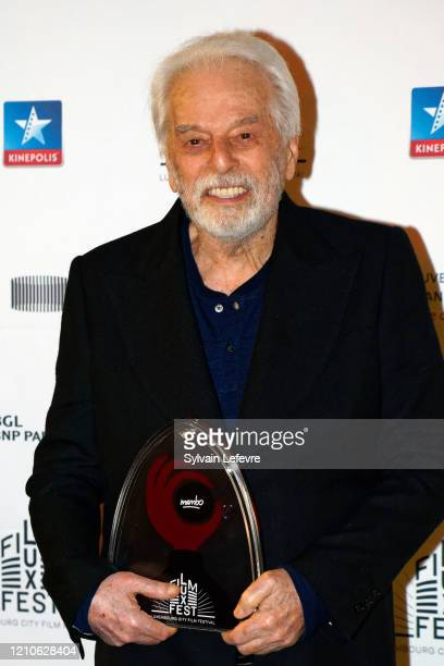 Director Alejandro Jodorowsky poses for photos after the tribute paid to him at the opening ceremony of 10th Luxembourg City Film Festival on March...