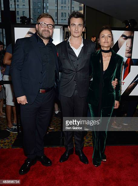 "Director Aleksander Bach poses with actors Rupert Friend and Hannah Ware at the New York premiere of ""Hitman Agent 47"" at AMC Empire 25 theater on..."