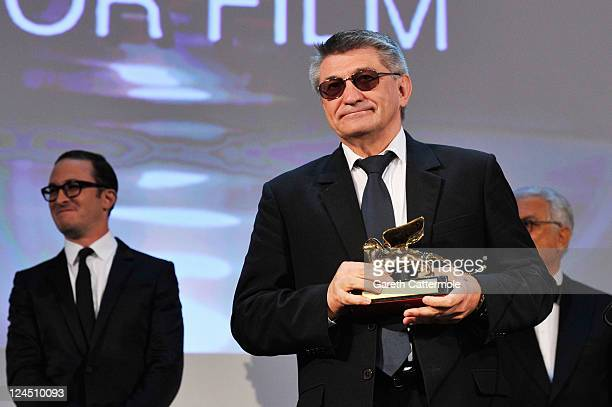 "Director Aleksandr Sokurov of ""Faust"" accepts the Golden Lion for Best Film during the Closing Ceremony during the 68th Venice Film Festival at..."
