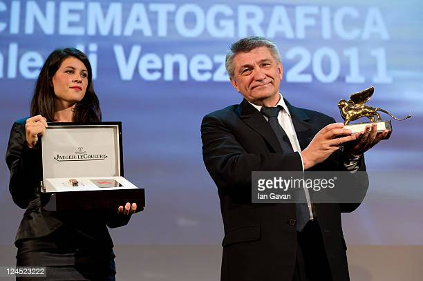 Director Aleksandr Sokurov of 'Faust' accepts the Golden Lion for Best Film during the Closing Ceremony during the 68th Venice Film Festival at...