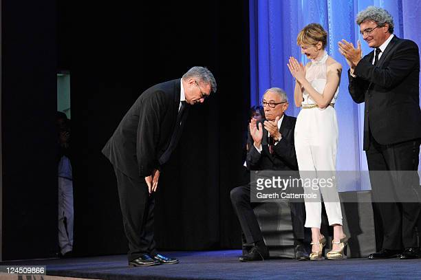 "Director Aleksandr Sokurov of ""Faust"" takes a bow as he accepts the Golden Lion for Best Film as jury members Andre Techine, Alba Rohrwacher and..."