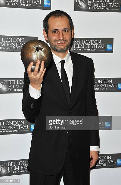 Director Aleksei Popogrebsky poses with the American Express Best Film Award for 'How I Ended This Summer' in the press room during the BFI London...
