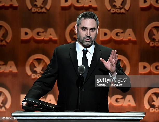 Director Alex Garland accepts the award for Outstanding Directorial Achievement of a FirstTime Feature Film Director for Ex Machina onstage at the...