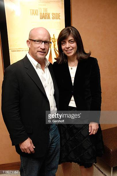 Director Alex Gibney and Vice President of HBO Documentary Films Nancy Abraham pose for pictures at the HBO Documentary Films Screening of Taxi to...