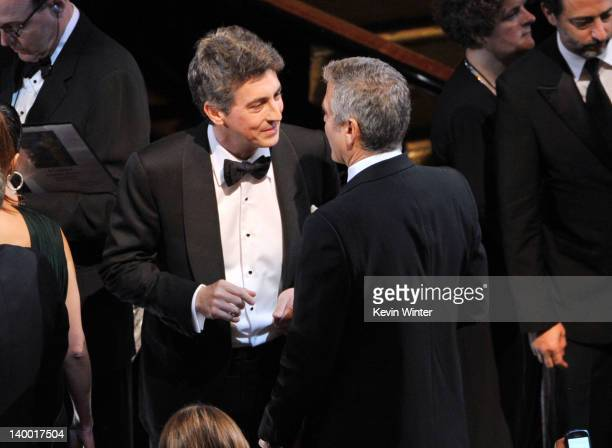 Director Alexander Payne and actor George Clooney attend the 84th Annual Academy Awards held at the Hollywood Highland Center on February 26 2012 in...