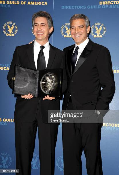 Director Alexander Payne and actor George Clooney pose in the press room during the 64th Annual Directors Guild Of America Awards at the Grand...