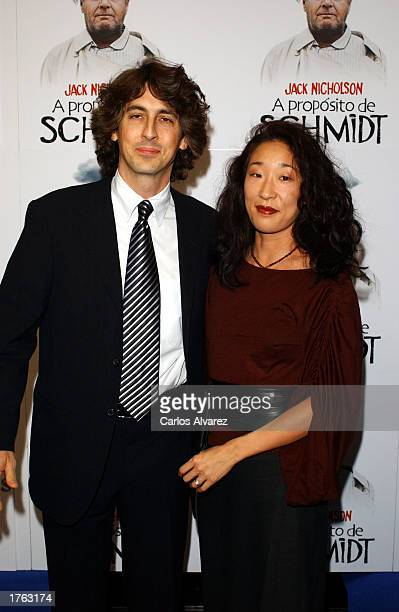 Director Alexander Payne and his wife actress Sandra Oh attend the Spanish premiere of his film 'About Schmidt' February 5 2003 at Palacio de la...
