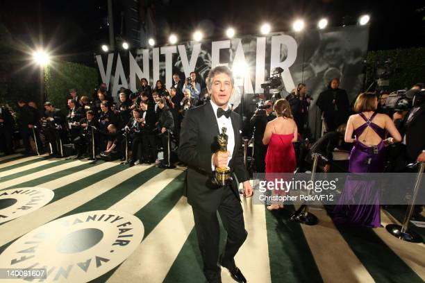 Director Alexander Payne poses with his Oscar for Best Adapted Screenplay at the 2012 Vanity Fair Oscar Party Hosted By Graydon Carter at Sunset...