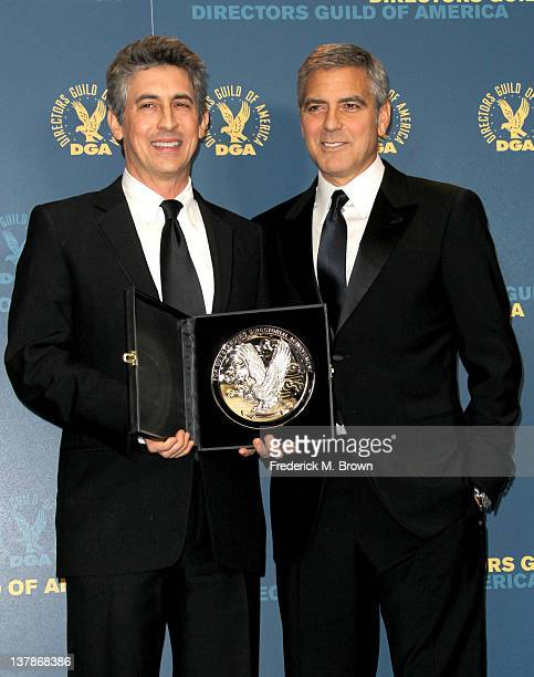 Director Alexander Payne recipient of the Feature Film Nomination Plaque for 'The Descendants' and presenter George Clooney pose in the press room...