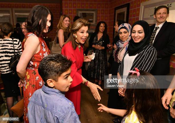 Director Alexandra Shiva and executive producer HRH Princess Firyal of Jordan greet the Alhalabi family during 'This is Home A Refugee Story' New...