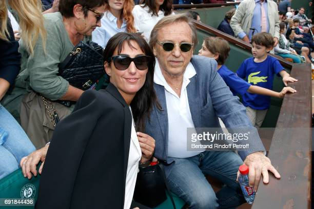Director Alexandre Arcady and Sabrina Guigui attend the 2017 French Tennis Open Day Seven at Roland Garros on June 3 2017 in Paris France