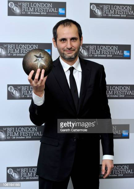 Director Alexei Popogrebsky poses with the Best Film Award for 'How I Ended This Summer' during the 54th BFI London Film Festival Awards at LSO St...