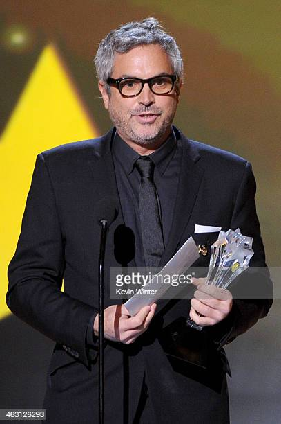 Director Alfonso Cuarón accepts the Best Director award for 'Gravity' onstage during the 19th Annual Critics' Choice Movie Awards at Barker Hangar on...