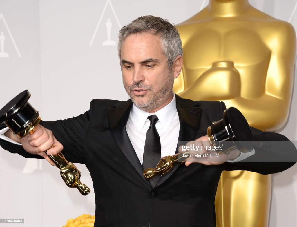 Director Alfonso Cuarón, winner of Best Achievement in Directing poses in the press room during the Oscars at Loews Hollywood Hotel on March 2, 2014 in Hollywood, California.