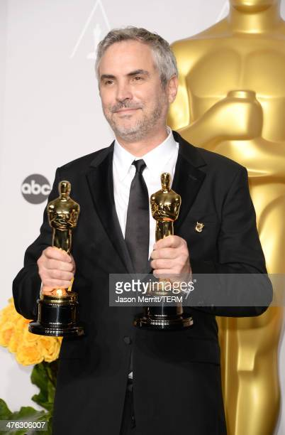 Director Alfonso Cuarón winner of Best Achievement in Directing poses in the press room during the Oscars at Loews Hollywood Hotel on March 2 2014 in...