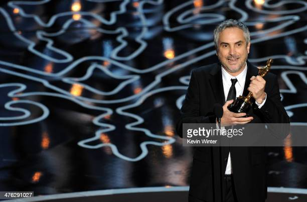 Director Alfonso Cuaron accepts the Best Achievement in Directing award for 'Gravity' onstage during the Oscars at the Dolby Theatre on March 2 2014...