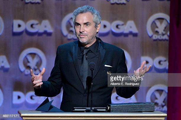 "Director Alfonso Cuaron accepts the Outstanding Directorial Achievement in Feature Film for 2013 award for ""Gravity"" onstage at the 66th Annual..."