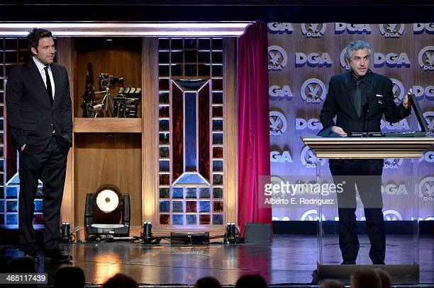 "Director Alfonso Cuaron accepts the Outstanding Directorial Achievement in Feature Film for 2013 award for ""Gravity"" from actor/director Ben Affleck..."