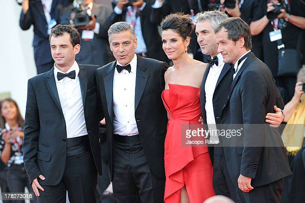 Director Alfonso Cuaron actress Sandra Bullock, actor George Clooney and Jonas Cuaron attend the Opening Ceremony And 'Gravity' Premiere during the...