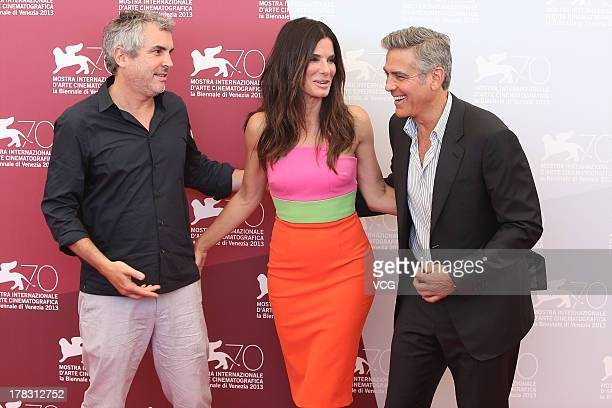 Director Alfonso Cuaron actress Sandra Bullock and actor George Clooney attend the Gravity Photocall during the 70th Venice International Film...