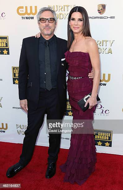 Director Alfonso Cuaron and aActress Sandra Bullock attend the 19th Annual Critics' Choice Movie Awards at Barker Hangar on January 16 2014 in Santa...