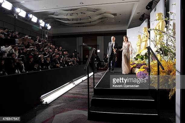 Director Alfonso Cuaron and actress Angelina Jolie pose in the press room during the Oscars at Loews Hollywood Hotel on March 2 2014 in Hollywood...