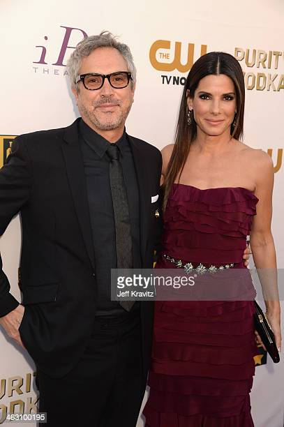 Director Alfonso Cuaron and actress Sandra Bullock attend the 19th Annual Critics' Choice Movie Awards at Barker Hangar on January 16 2014 in Santa...
