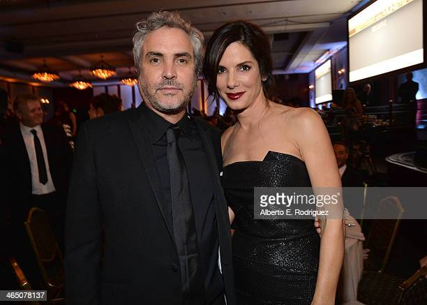 Director Alfonso Cuaron and actress Sandra Bullock attend the 66th Annual Directors Guild Of America Awards held at the Hyatt Regency Century Plaza...