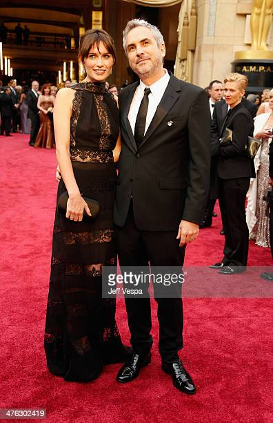 Director Alfonso Cuaron and Annalisa Bugliani attend the 86th Oscars held at Hollywood Highland Center on March 2 2014 in Hollywood California