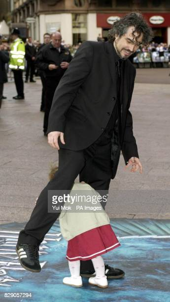 Director Alfonso Cuaron and his daughter Bu arrive for the UK premiere of Harry Potter And The Prisoner of Azkaban at the Odeon Leicester Square in...