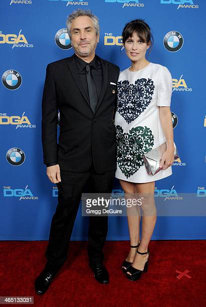 Director Alfonso Cuaron and Sheherazade Goldsmith arrive at the 66th Annual Directors Guild Of America Awards at the Hyatt Regency Century Plaza on...