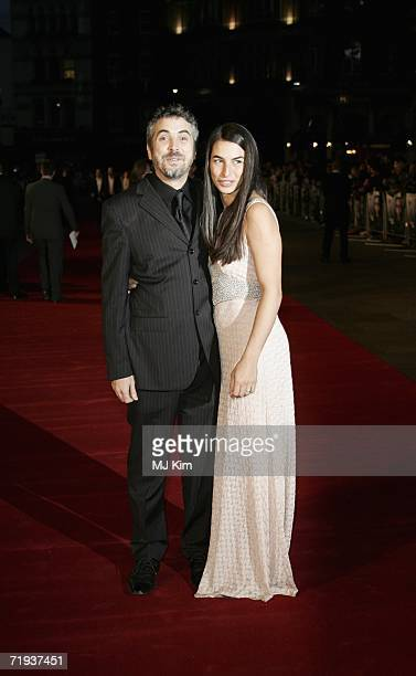 Director Alfonso Cuaron and wife Annalisa Bugliani arrive at the UK premiere of 'Children of Men' held at the Odeon in Leicester Square on September...
