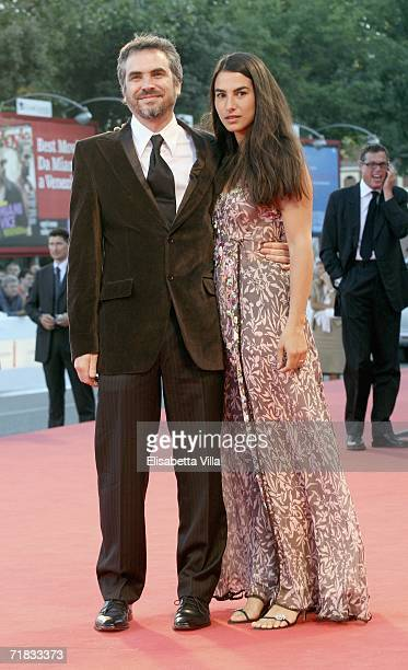 Director Alfonso Cuaron and wife Annalisa Bugliani attend the Closing Ceremony of the 63rd Venice Film Festival on September 9 2006 in Venice Italy