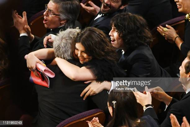 Director Alfonso Cuaron hugs Tess Bu Cuaron and Olmo Cuaron during the 91st Annual Academy Awards at Dolby Theatre on February 24 2019 in Hollywood...