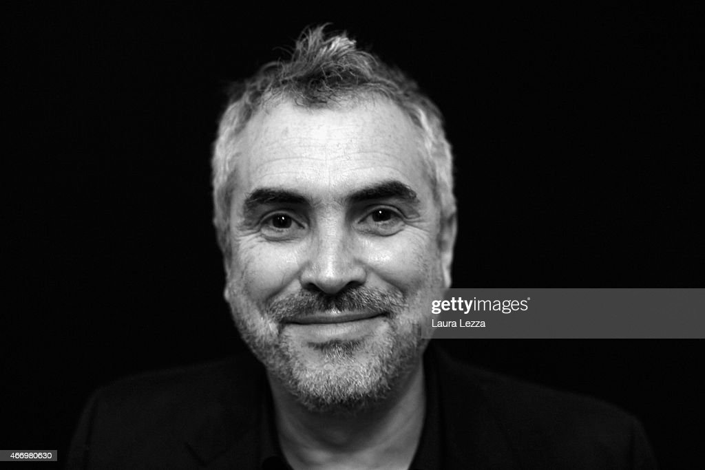 Director Alfonso Cuaron poses for a photo while attending the Lucca Film Festival on March 19, 2015 in Lucca, Italy.