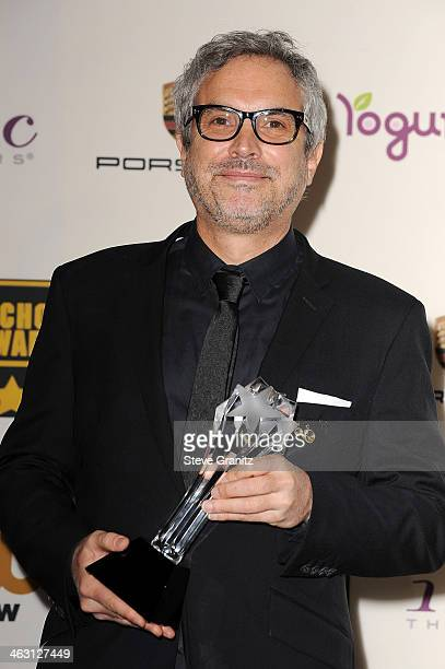 Director Alfonso Cuaron poses in the press room during the 19th Annual Critics' Choice Movie Awards at Barker Hangar on January 16 2014 in Santa...