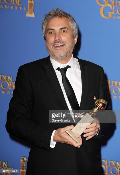 Director Alfonso Cuaron poses in the press room during the 71st Annual Golden Globe Awards held at The Beverly Hilton Hotel on January 12 2014 in...