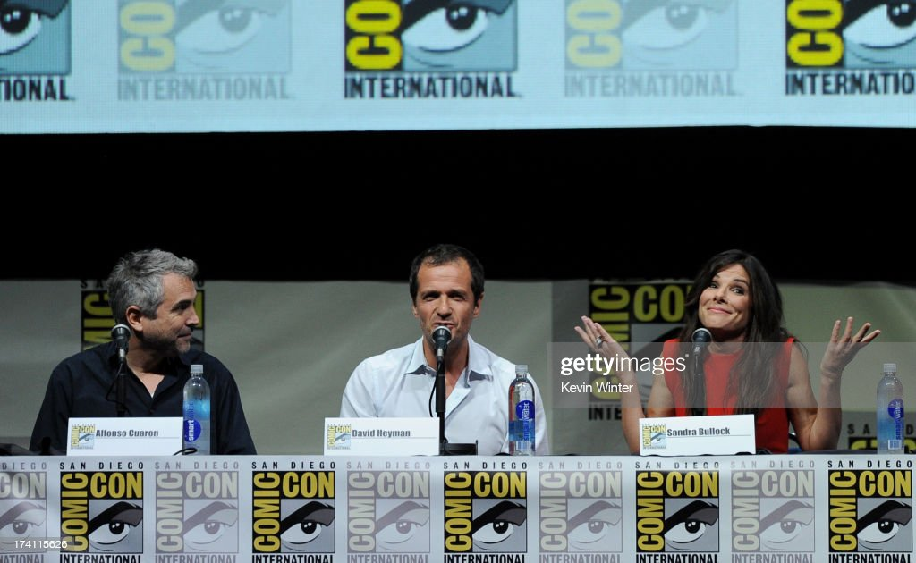 Director Alfonso Cuaron, producer David Heyman and actress Sandra Bullock speak onstage at the Warner Bros. and Legendary Pictures preview of 'Gravity' during Comic-Con International 2013 at San Diego Convention Center on July 20, 2013 in San Diego, California.