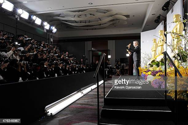 Director Alfonso Cuaron winner of Best Achievement in Directing poses in the press room during the Oscars at Loews Hollywood Hotel on March 2 2014 in...
