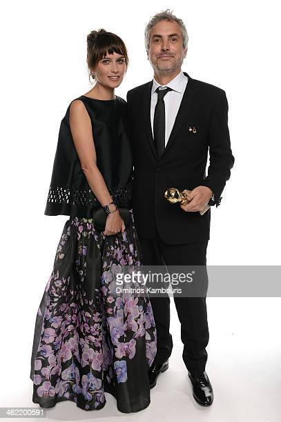 Director Alfonso Cuaron winner of Best Director for 'Gravity' and writer Sheherazade Goldsmith pose for a portrait during the 71st Annual Golden...