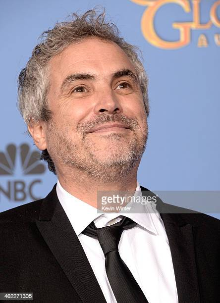 Director Alfonso Cuaron winner of Best Director for 'Gravity' poses in the press room during the 71st Annual Golden Globe Awards held at The Beverly...