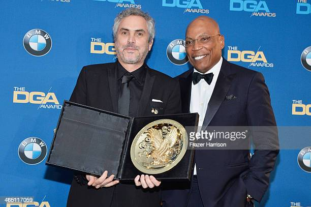 """Director Alfonso Cuaron winner of the Outstanding Directorial Achievement in Feature Film for 2013 award for """"Gravity"""" and DGA President Paris..."""