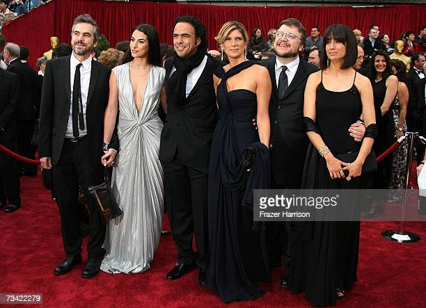 Director Alfonso Cuaron with wife Annalisa Bugliani Director Alejandro Gonzalez Inarritu and wife Maria Eladia and Director Guillermo del Toro with...