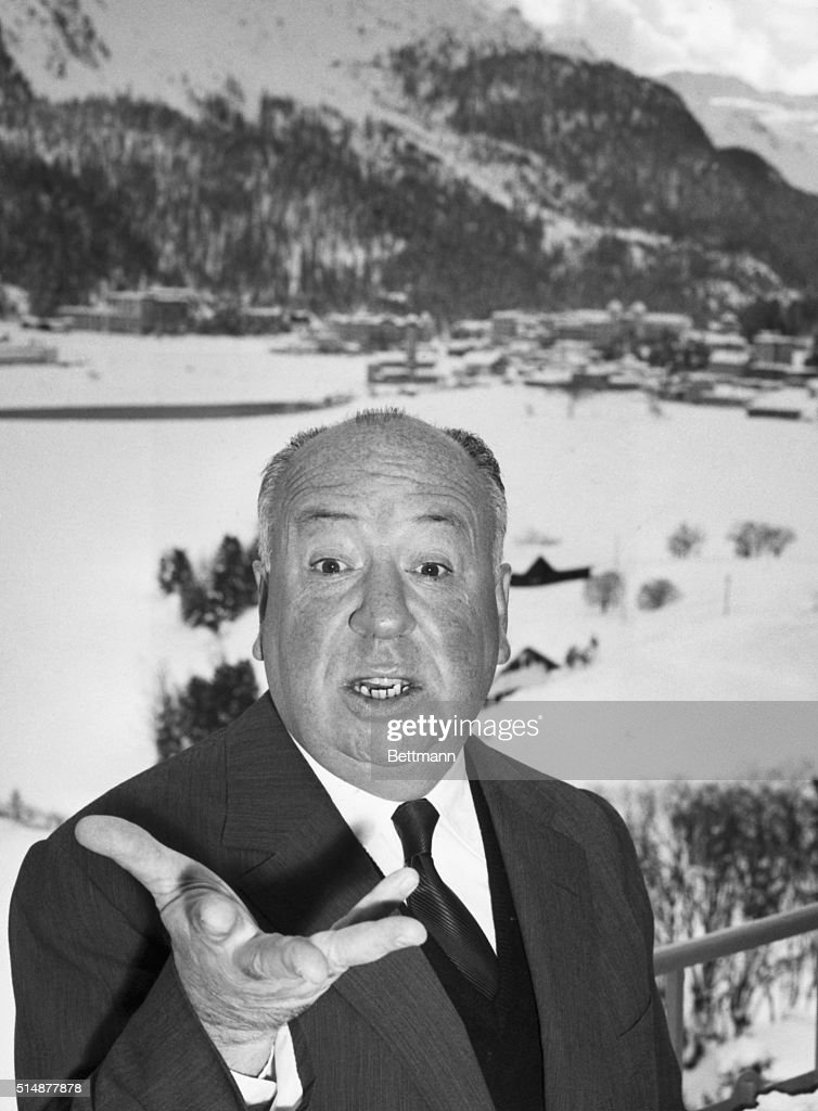 Director Alfred Hitchcock in a typical pose, St. Moritz, 1938.