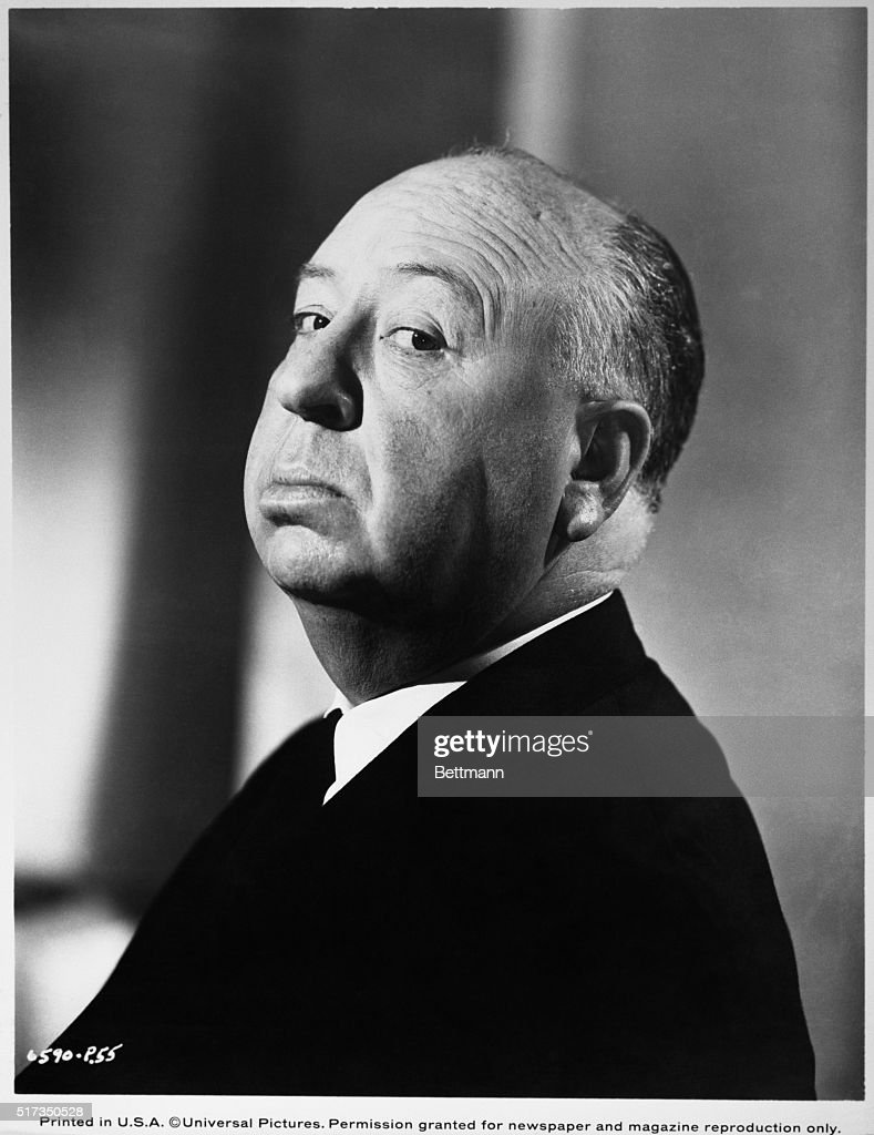 Director Alfred Hitchcock in a typical pose. Undated Photo.